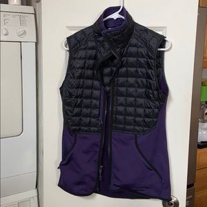 NWOT Patagonia purple and black size M vest.